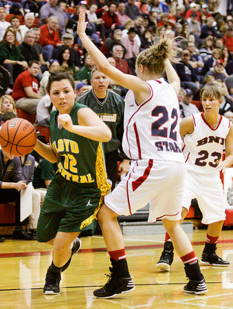 Floyd Central guard Shelby Rost drives to the basket during their championship game against Bedford North Lawrence in the New Albany sectional tournament on Saturday. Bedford North Lawrence won the game, 54-34. Staff photo by Christopher Fryer
