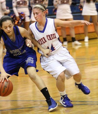 Silver Creek senior Lexi McFarland applies pressure in the backcourt against North Harrison on Wednesday. Staff photo by C.E. Branham