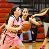 New Albany guard Stephanie Iglesias covers Floyd Central guard Shelby Rost during their game at New Albany on Saturday. New Albany won the game in double overtime, 69-64. Staff photo by Christopher Fryer