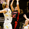 New Albany guard Lauren Camm goes up for a shot during their game at Scottsburg on Thursday. Staff photo by Christopher Fryer