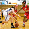Providence's Michaela Hoke and Jeffersonville's Nichole Midgett and Nycia Ford fight for a loose ball during their game at Providence on Thursday. Jeffersonville won the game, 35-19. Staff photo by Christopher Fryer
