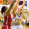 Jeffersonville guard Catera Stevenson blocks a shot by Floyd Central forward Abbie Engle during their game at Floyd Central on Thursday. Staff photo by Christopher Fryer