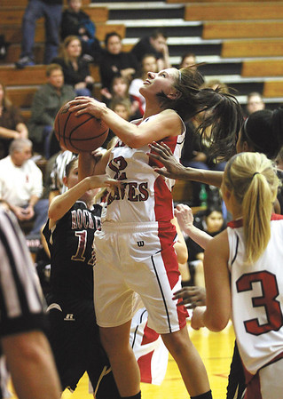 Borden junior Leslie Beatty is fouled while shooting by a Rock Creek defender in a 1A sectional semi-final at Borden Friday night.  The Lady Braves won 68-12.  Staff photo by C.E. Branham