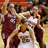 New Albany guard Lauren Camm moves the ball out of pressure during their home game against Ballard on Thursday. New Albany lost the game, 60-51. Staff photo by Christopher Fryer