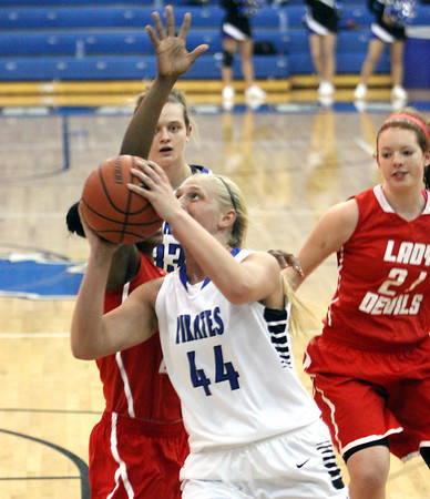 Charlestown junior Emily Young gets to the hoop Thursday night against Jeffersonville. Staff photo by C.E. Branham