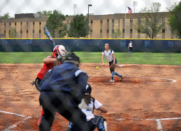 Pioneer senior Sierra Collett delivers a pitch during Providences' game against New Albany on Tuesday. The Bulldogs would take the 7-6 lead in the seventh inning, but the game was suspended due to rain.<br /> Staff photo by Tyler Stewart