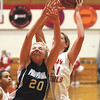 Jeffersonville sophomore Haley Vogen grabs a offensive rebound over Providence senior Alex Stiner Thursday at Jeff.  Staff photo by C.E. Branham