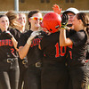 Borden's Caitlin McKinley is congratulated by her teammates after hittting in the winning run during the Braves' victory over New Washington in Borden on Tuesday. Staff photo by Christopher