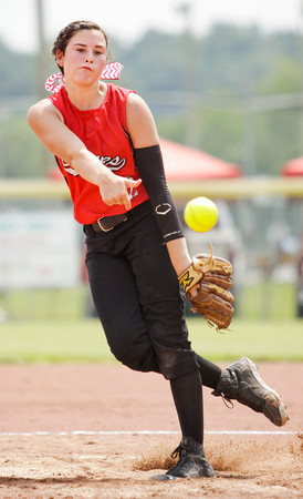 Borden freshman Paige Schindler pitches during the Braves' 1-0 win over Lanesville at the Lanesville Sectional on Monday. Staff photo by Christopher Fryer