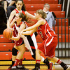 New Albany guard Lauren Camm moves to pass the ball out of pressure during their game against Bedford North Lawrence in the New Albany sectional tournament on Tuesday. Staff photo by Christopher Fryer