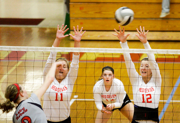 Jeffersonville junior Jenna Reinhardt, left, and senior Sam Grider attempt to block a shot by Southwestern's Karli Long during their game at Jeffersonville on Wednesday. Staff photo by Christopher Fryer