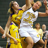Floyd Central forward Abbie Engle is fouled on the drive by Scottsburg defender Katie Wampler. Staff photo by C.E. Branham