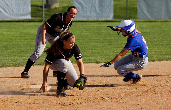 Silver Creek's Kami Pennington slides safely into second base during the Dragons' 9-3 home win over Henryville on Monday. Staff photo by Christopher Fryer