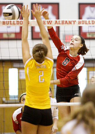 New Albany junior Brook McCoy goes up for a shot during their match against Evansville Central in the championship round of the River City Invitational at New Albany on Saturday. New Albany won the match in two sets, 25-21, 25-18. Staff photo by Christopher Fryer