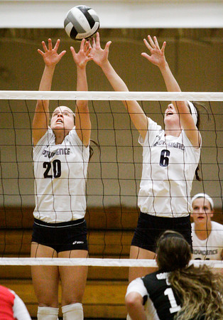 Providence juniors Patricia Mattingly, left, and Taylor Wilson attempt to block a shot during their home match against Brownstown on Thursday. Providence won the match in three sets. Staff photo by Christopher Fryer
