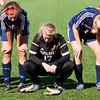Upset after their 2-0 loss to Mishawaka Marian in the Class A state championship match, Providence midfielder Kacey Wallace, left, keeper Autumn Meyer, center, and midfielder Katelyn Koopman wait to accept their runner-up awards in Indianapolis on Saturday. Staff photo by Christopher Fryer