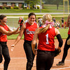From left, Borden freshmen, Riley Schindler, Paige Schindler and Haley Shouse, and senior Shelbie Farvour celebrate following the Braves' 1-0 win over Lanesville at the Lanesville Sectional on Monday. Staff photo by Christopher Fryer