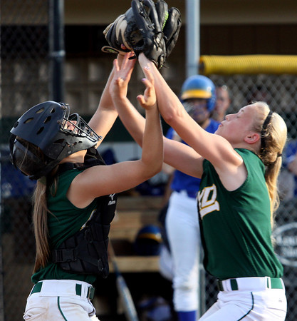 Floyd Central catcher Taylor McClure and pitcher Morgan Harper nearly collide while making a play on a pop up. McClure made the catch for the out in the 4A Regional. Staff photo by C.E. Branham
