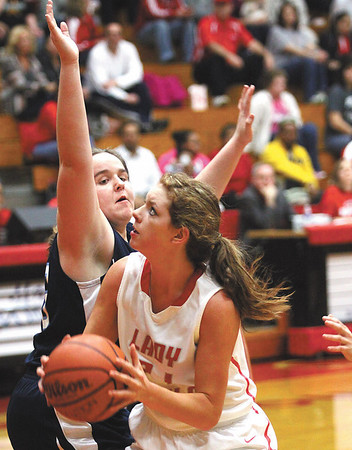 Jeffersonville sophomore Haley Vogen works the lane against Providence defender Alex Stiner for two Thursday night.  Staff photo by C.E. Branham