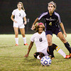 Providence junior Jordan Reger and New Albany senior Jelana Iglesias collide during their game at New Albany on Tuesday. Providence won the game, 6-1. Staff photo by Christopher Fryer