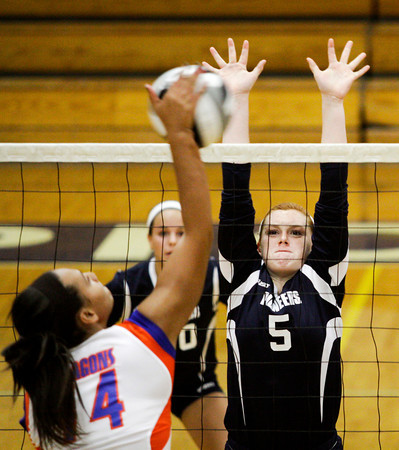 Providence High School sophomore Maddie Bivens attempts to block a shot by Providence High School junior Morgan Reining during their match at Providence on Wednesday evening. Providence won the match in the first three sets. Staff photo by Christopher Fryer