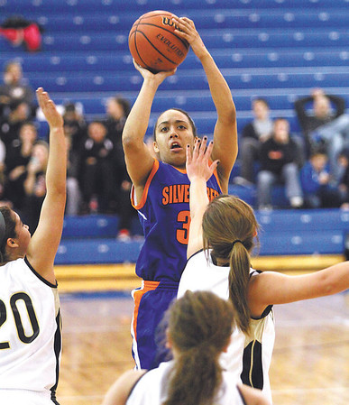 Silver Creek junior Carissa Brown pulls up for a jumper against Corydon Central Wednesday night at Charlestown.  Staff photo by C.E. Branham