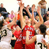 Borden junior Carson Casey battles for a rebound at Henryville on Thursday night. Staff photo by C.E. Branham