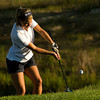 Providence High School senior Morgan Boone chips the ball onto the eighth green during the Sunnyside Classic at Champions Pointe Golf Club in Henryville on Wednesday afternoon. Boone shot a 48 in the nine hole round. Staff photo by Christopher Fryer