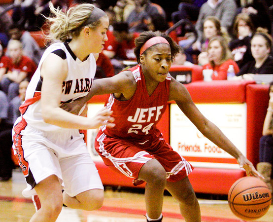 Jeffersonville Aurreeshae Hines moves the ball down court during the Red Devils' game at New Albany on Friday. Staff photo by Christopher Fryer