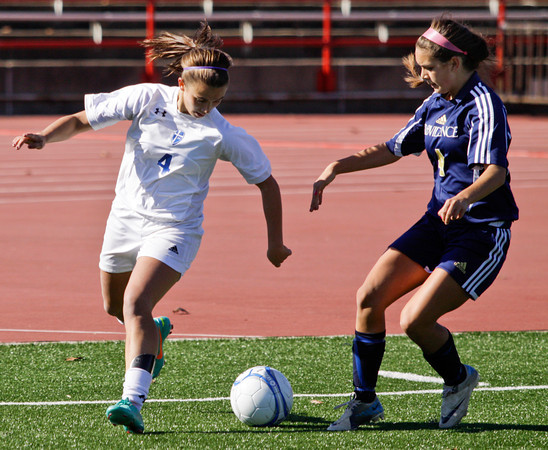 Providence's Jordan Reger and Mishawaka Marian's D.J. Veldman fight for possession of the ball during the second half of their Class A state championship game in Indianapolis on Saturday. Mishawaka Marian won the game, 2-0. Staff photo by Christopher Fryer
