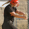 Borden's Caitlin McKinley connects for an RBI that ended the Braves' nine-inning win over New Washington in Borden on Tuesday. Staff photo by Christopher Fryer