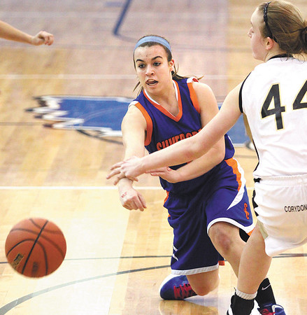 Silver Creek point guard Brooke Barnett feeds the post in the Lady Dragons 3A sectional opener against Corydon Central Wednesday night at Charlestown.  Staff photo by C.E. Branham