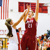 Jeffersonville center Haley Vogen goes up for a shot during the Red Devils' game at New Albany on Friday. Staff photo by Christopher Fryer