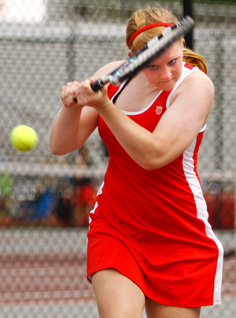 Jeffersonville High School junior Morgan Reilly returns the ball during her No. 1 singles match against Columbus East High School at Jeffersonville on Saturday afternoon. Staff photo by Christopher Fryer