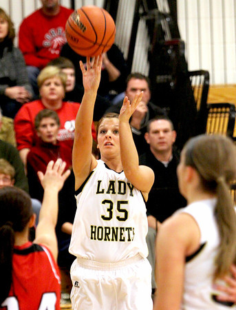 Henryville senior Chelsea Lamotte fires a jumper against Borden Thursday night at Henryville. Staff photo by C.E. branham