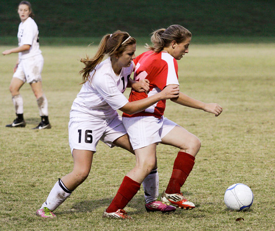 Corydon Central junior Emily Barry attempts to steal the ball from Jeffersonville freshman Kayla Broy during their game in the Indiana High School Athletic Association Girls Soccer Sectional at Floyd Central on Tuesday. Jeffersonville lost the game, 4-2. Staff photo by Christopher Fryer