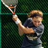Floyd Central High School junior Olivia Boesing returns the ball to Jeffersonville High School junior Julianna Jenks during their No. 1 singles match at the Indiana High School Athletic Association Girl's Tennis Regional tournament at Floyd Central on Tuesday evening. Boesing won the match in two sets, 6-0, 6-0. Staff photo by Christopher Fryer