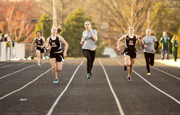 Floyd Central and New Albany runners compete in the 200-meter dash during their meet at New Albany on Tuesday. Staff photo by Christopher Fryer