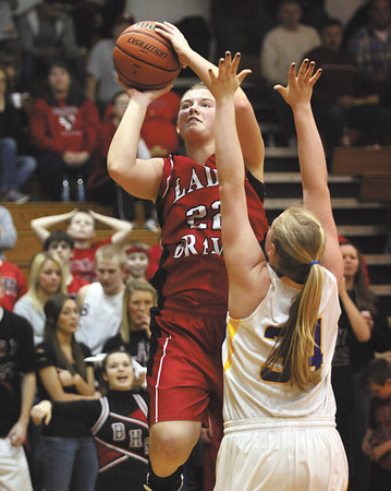 Borden senior Erin Mikel puts up a shot over New Washington defender Caroline Ricks.  Staff photo by C.E. Branham