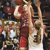 Borden senior Erin Mikel puts up a shot over New Washington defender Caroline Ricks.  Staff photo by C.E. Branham