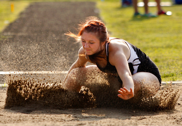New Albany junior Reid Milam lands in the sand during the long jump competition at the Indiana High School Athletic Association Girls Track Sectional at Floyd Central High School on Tuesday evening. Staff photo by Christopher Fryer
