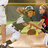 Floyd Central High School outfielder Katelin Kaiser continues to scramble for the base after being tagged out by Bedford North Lawrence High School third baseman Portia Baker during their game in the Hoosier Hills Conference Softball Tournament at Floyd Central on Friday night. Floyd Central won the game in extra innings, 2-1. Staff photo by Christopher Fryer
