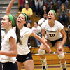 Providence volleyball players Taylor Wilson and Patricia Mattingly (20) celebrate a huge kill by teammate Haley Libs as the Lady Pioneers rolled to the 2A Regional championship over Southwestern. Staff photo by C.E. Bran ham