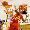 Floyd Central guard Abbie Engle goes up for a shot during their game against Jeffersonville in the New Albany sectional tournament on Tuesday. Floyd Central won the game 62-48. Staff photo by Christopher Fryer