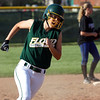 Floyd Central Lady Highlander Kallie Krammes turns to round third and score a run against Charlestown on Thursday evening. Staff photo by C.E. Branham