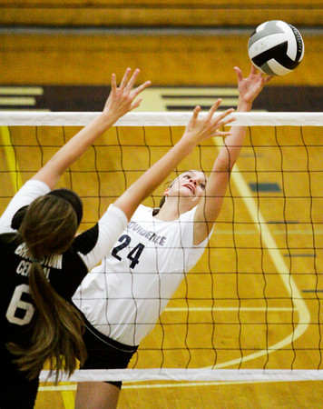 Providence junior Haley Libs attempts to tip the ball over the net during their home match against Brownstown on Thursday. Providence won the match in three sets. Staff photo by Christopher Fryer