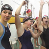 New Albany swimmers Alexis Lete, Hannah Manger and Rachel Klein celebrate after learning they and teammate Abby Litkenhous set a new sectional record in the 200 yard medley relay with a time of 1:51.22.  Staff photo by C.E. Branham