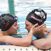 Jeffersonville senior Hanna Martin consoles New Albany freshman Alexis Lete after Martin edged Lete for the sectional championship in the 100 yard butterfly.  Staff photo by C.E. Branham