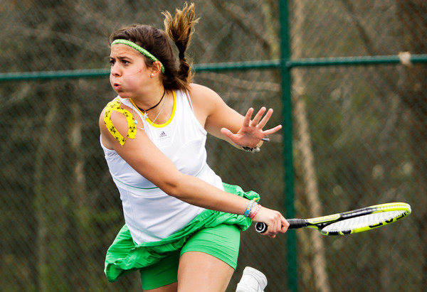 Floyd Central junior Giorgia Rosetto returns a shot to New Albany junior Anne Marie Mattox during their No. 1 singles match at Floyd Central on Monday. Staff photo by Christopher Fryer