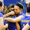 Christian Academy of Indiana senior Michaela Roberts comforts freshman Alex Falcone after their regional tournament loss to Trinity Lutheran at CAI on Tuesday. Staff photo by Christopher Fryer